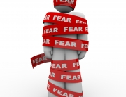 bigstock-A-man-is-wrapped-in-red-tape-r-120313