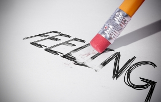 Pencil erasing the word feeling on paper