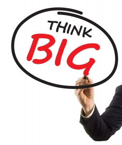 businessman hand with marker writing text think big