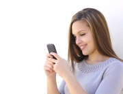 Happy Woman Texting On A Smartphone Looking At Phone
