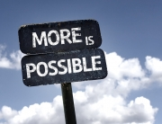 More Is Possible sign with clouds and sky background