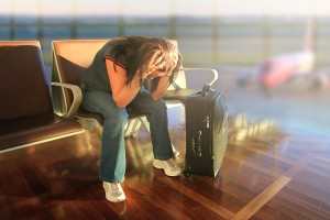 bigstock-Depressed-woman-awaiting-for-plane-012912