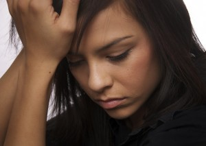bigstock-Sad-young-woman-looking-down--052113